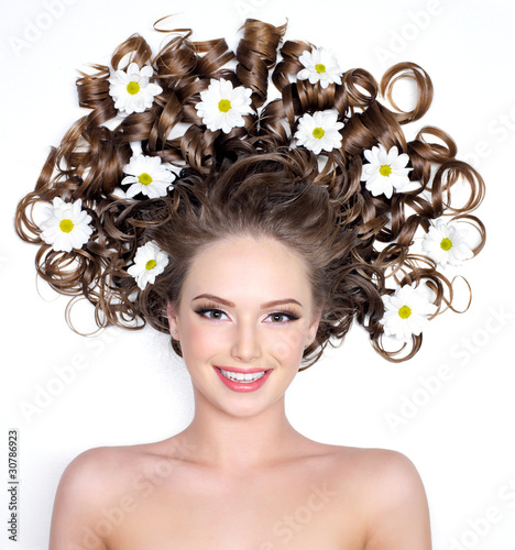 Beautiful smiling woman with flowers in hair