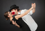 Professional dancers, girl holding rose in mouth