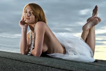 girl lying on the roof