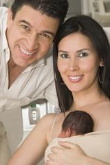 Mom, Dad And Newborn Baby
