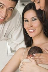 Happy Mom, Dad And Newborn Baby