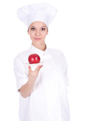 female cook in white uniform and hat with apple