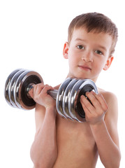 Little boy holds  heavy dumbbell