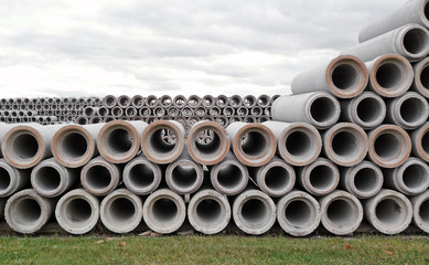 Stacked rows of concrete drainage pipes