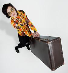 Beautiful woman posing at studio with baggage
