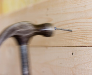 Hammer used to build a wooden wall.