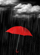 red umbrella in heave rain
