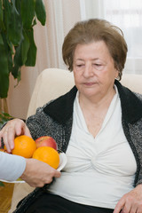 Senior woman with fruit