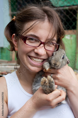Girl with gray rabbit