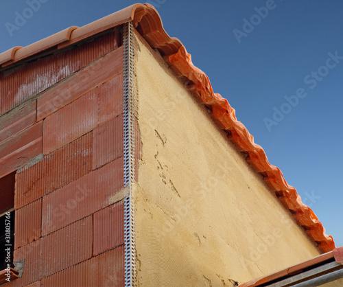 Crépissage d'un mur en briques