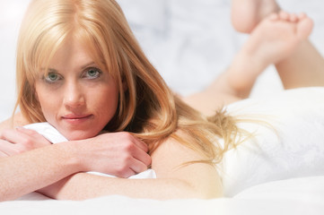 pretty red haired woman lying in bed