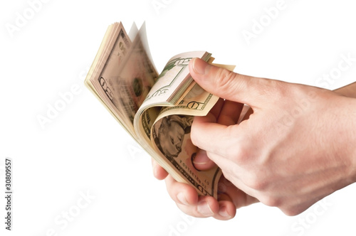 The human hand holding a bunch of USA dollars