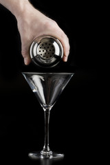 Pouring martini cocktail