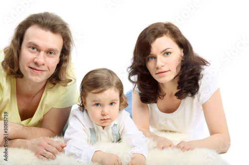 Happy young family - mother, father and little daughter
