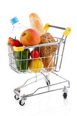 Shopping trolley full of goods on white background
