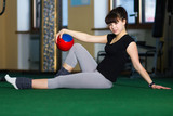 woman with a ball involved in fitness poster