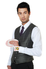 Young man magican holding cards in hand