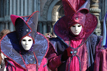 Two masks at St. Mark's Square,Venice carnival 2011
