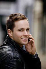 A young man talking on a mobile phone