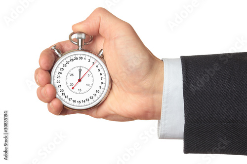 Leinwandbild Motiv Man's hand holding stopwatch.