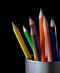 holder basket full of pencils on black
