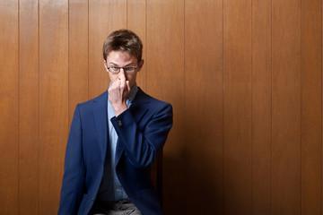 Young Man Adjusting Eyeglasses