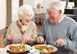 Senior Couple Enjoying Meal Together - 30838721
