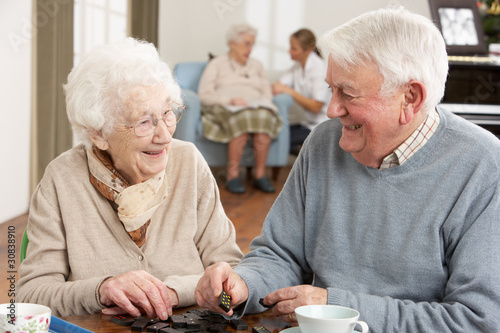 Couple Playing Dominoes At Day Care Centre