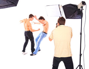 Two shirtless men fighting