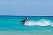 canvas print picture - Man riding jet ski