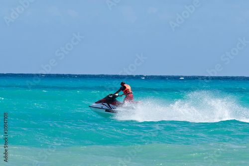 Staande foto Water Motorsp. Man riding jet ski