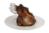 Roasted pork foreloin on plate isolated on wjhite