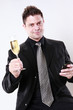 Businessman cheers with his cellphone in hand