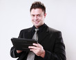 Young businessman and his tablet pad