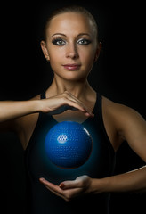 Fitness girl with magic ball