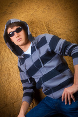 Young male model wearing hoodie shirt and sunglasses