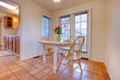 Happy dining room with orange tile floor
