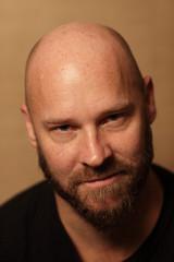 Handsome bald man with a beard
