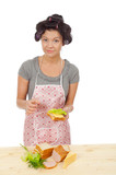 Beautiful cooking woman in apron with sandwich. poster