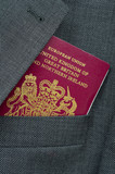 Business Travel Image Of A UK Passport In A Suit Pocket poster