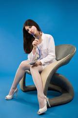 Pretty nurse sitting in a chair