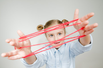 Connection - little girl playing cats cradle game