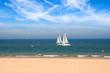 Two yachts racing near seashore
