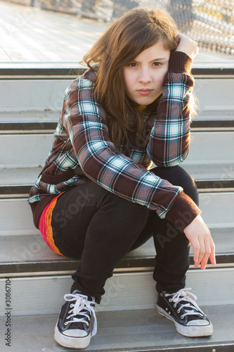 Cute Teenage Girl with Serious Expression