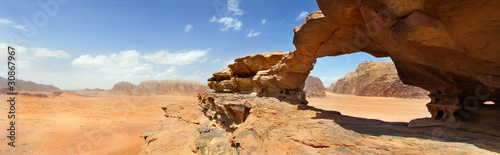 natural bridge and panoramic view of Wadi Rum desert, Jordan