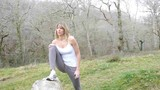Woman doing stretching exercises in countryside