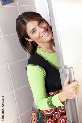 Woman open the refrigerator door