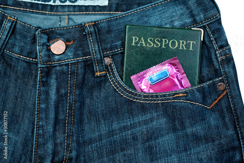 Passport with condom in pocket. Safety travel theme