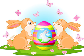 Bunnies holds Easter Egg