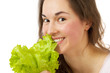 Beautiful healthy girl with lettuce